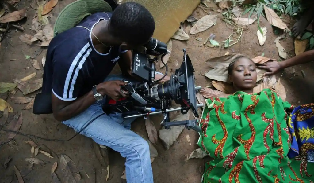 A cameraman films a scene for the movie October 1, a police thriller directed by Kunle Afolayan, at a rural location in Ilaramokin village, southwest Nigeria.